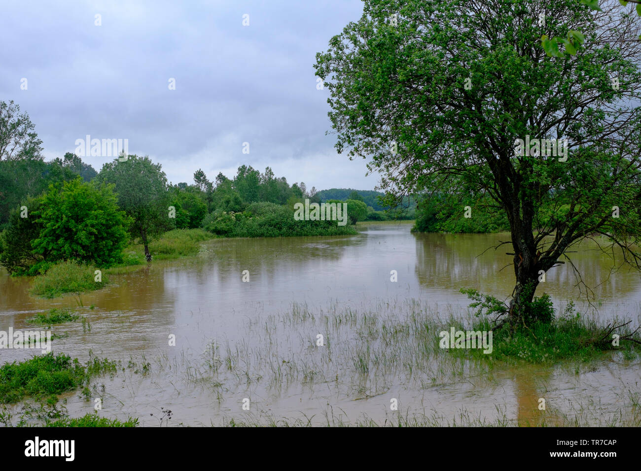 small river overflows after a period of prolonged heavy rain flooding the surrounding fields and meadows zala county hungary Stock Photo