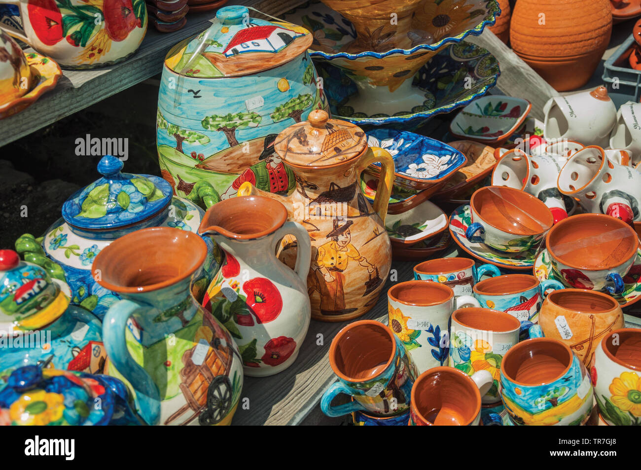 Colorful handmade porcelain pots and bowls, typical of the