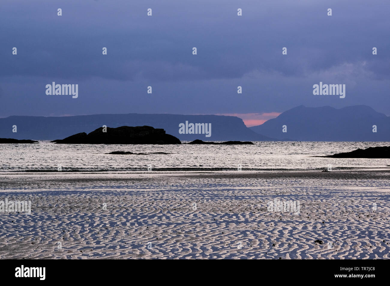 Looking out to the islands of Eigg and Rum in the Scottish Islands - Stock Image
