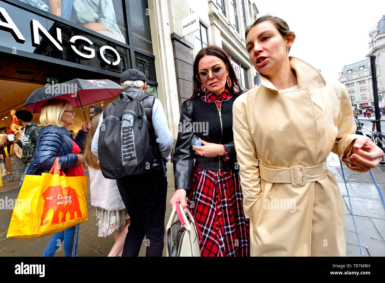 London, England, UK. People shopping in Oxford Street on a rainy day - Stock Image