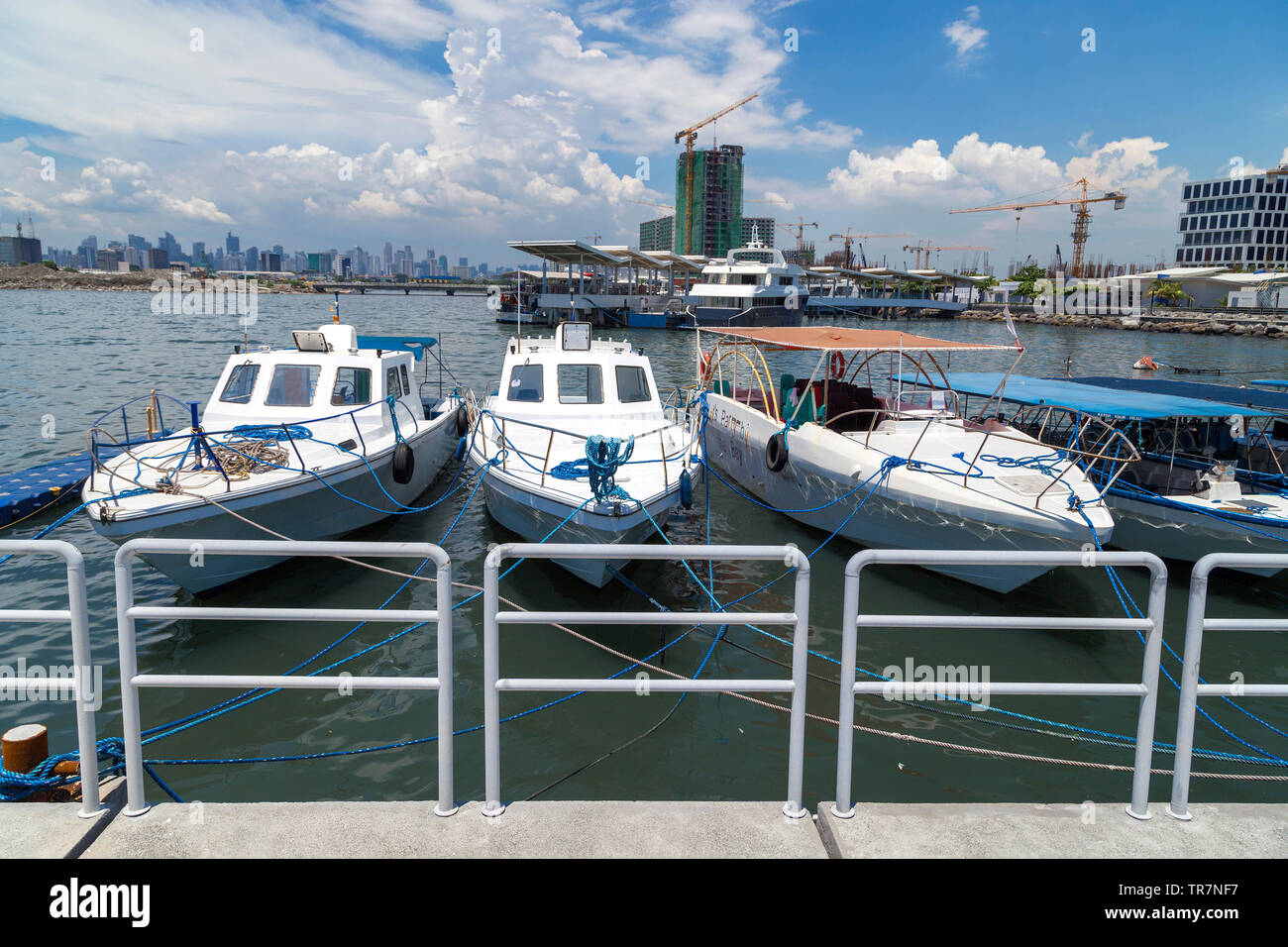 Anchored boats in Manila bay pier port, Pasay, Philippines - Stock Image