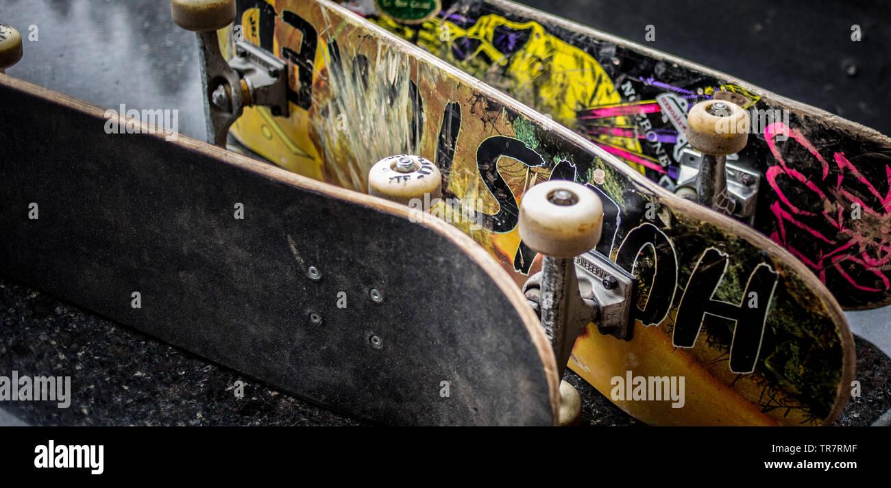 Skateboards at a skatepark - Stock Image