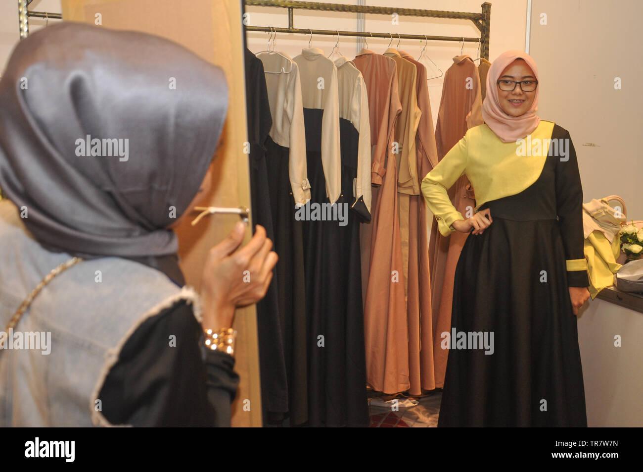 An Indonesian muslim woman fits a clothe at Indonesia Moslem
