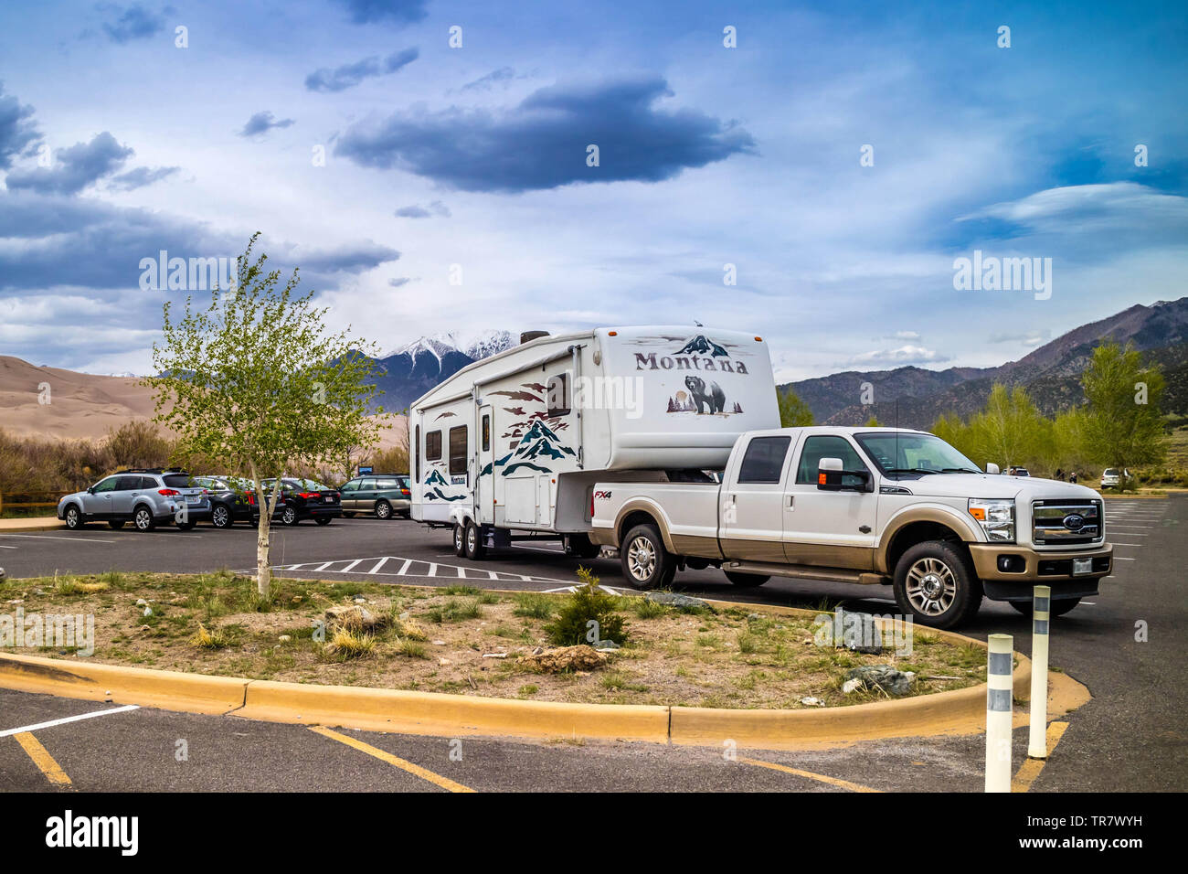 Great Sand Dunes NP, CO, USA - May 5, 2017: The F350 Ford with a trailer parked along the preserved park Stock Photo