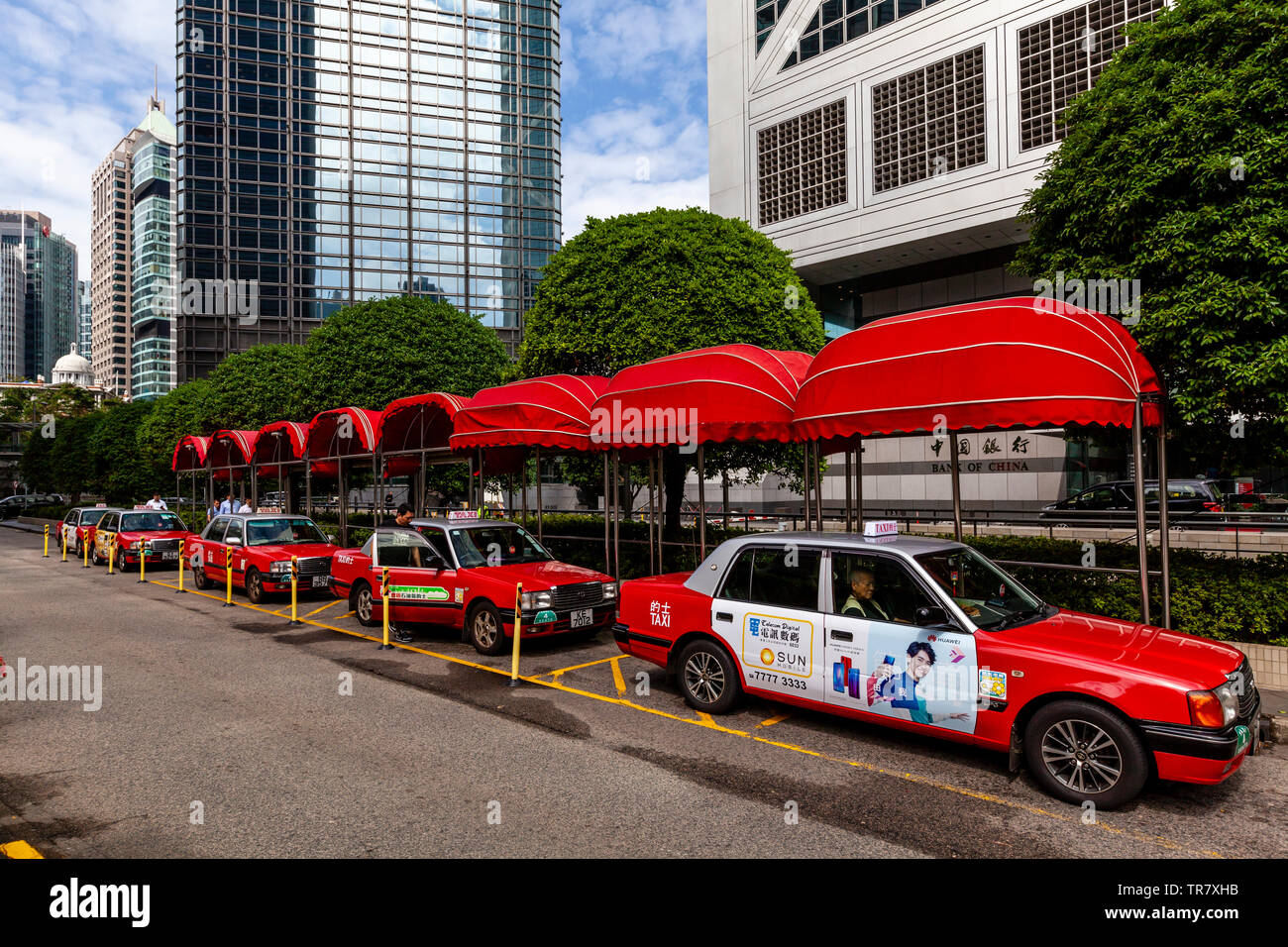 A Line Of Red and White Taxicabs, Hong Kong, China - Stock Image