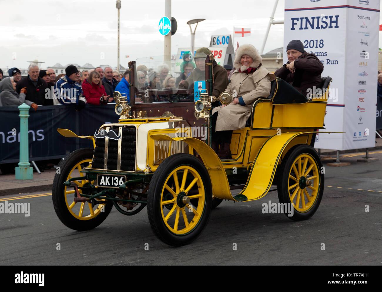 Mr Peter Boulding driving his 1903 Darracq, across the finishing line of the 2018 London to Brighton Veteran Car Run - Stock Image