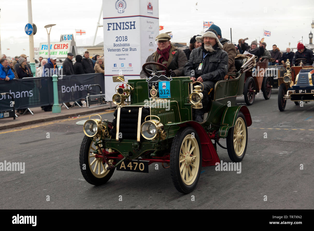 Mr Peter John Newens driving a 1904 Star, across the finishing line of the 2018 London to Brighton Veteran Car Run - Stock Image