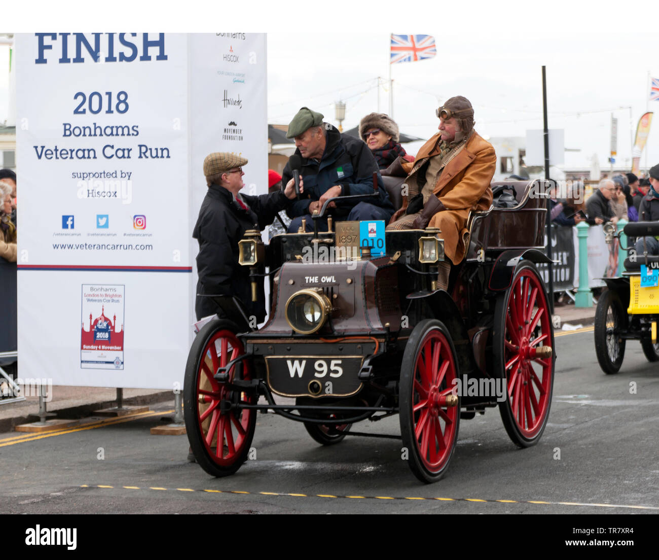 Mr Michael Flather being interviewed, after completing the 2018 London to Brighton Veteran Car Run, in his 1897 Daimler - Stock Image