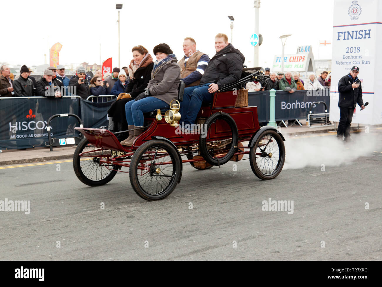 A 1902 Stanly Steamer, crosses the finishing line at the end of the 2018 London to Brighton Veteran Car Run - Stock Image