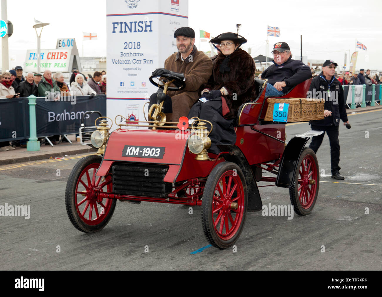 Mr Richard Rimmer driving a 1904 Ford, across the finishing line of the 2018 London to Brighton Veteran Car Run Stock Photo