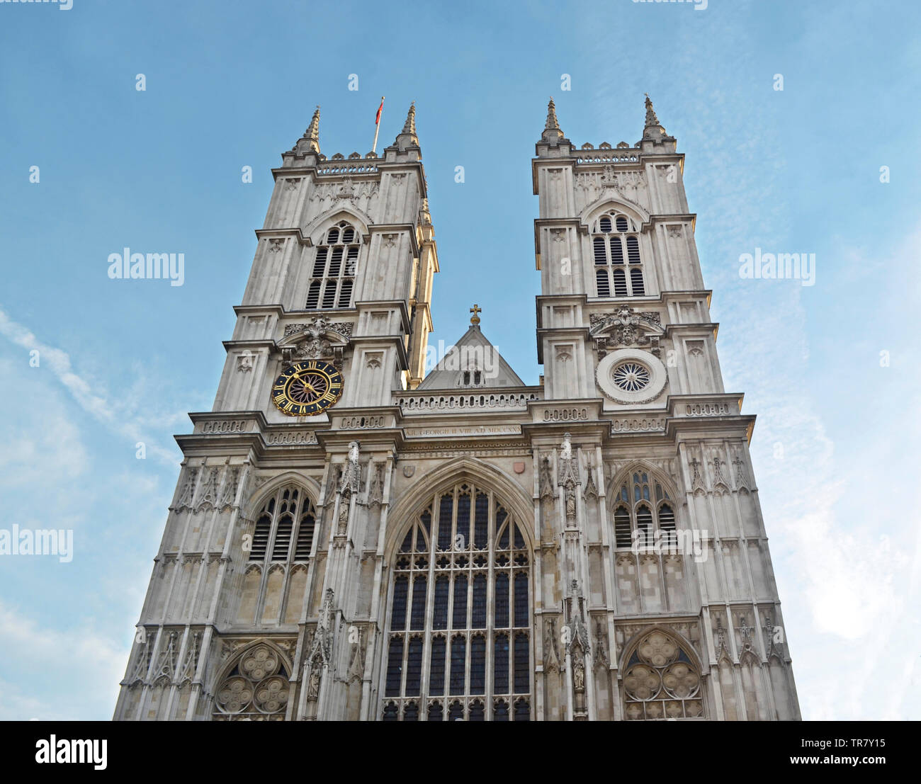 Westminster Abbey is a church in London. It is located in the City of Westminster west of the Palace of Westminster. Stock Photo