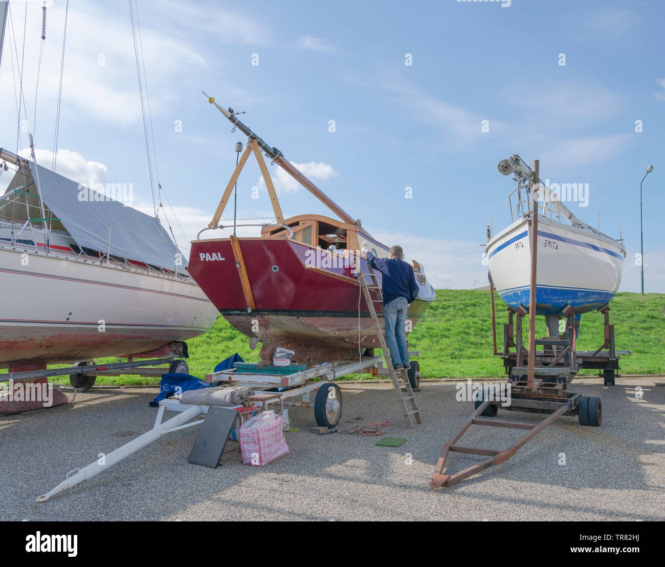 Paal, Netherlands, 27 March 2019, Man is his sailing boat to refurbishing - Stock Image
