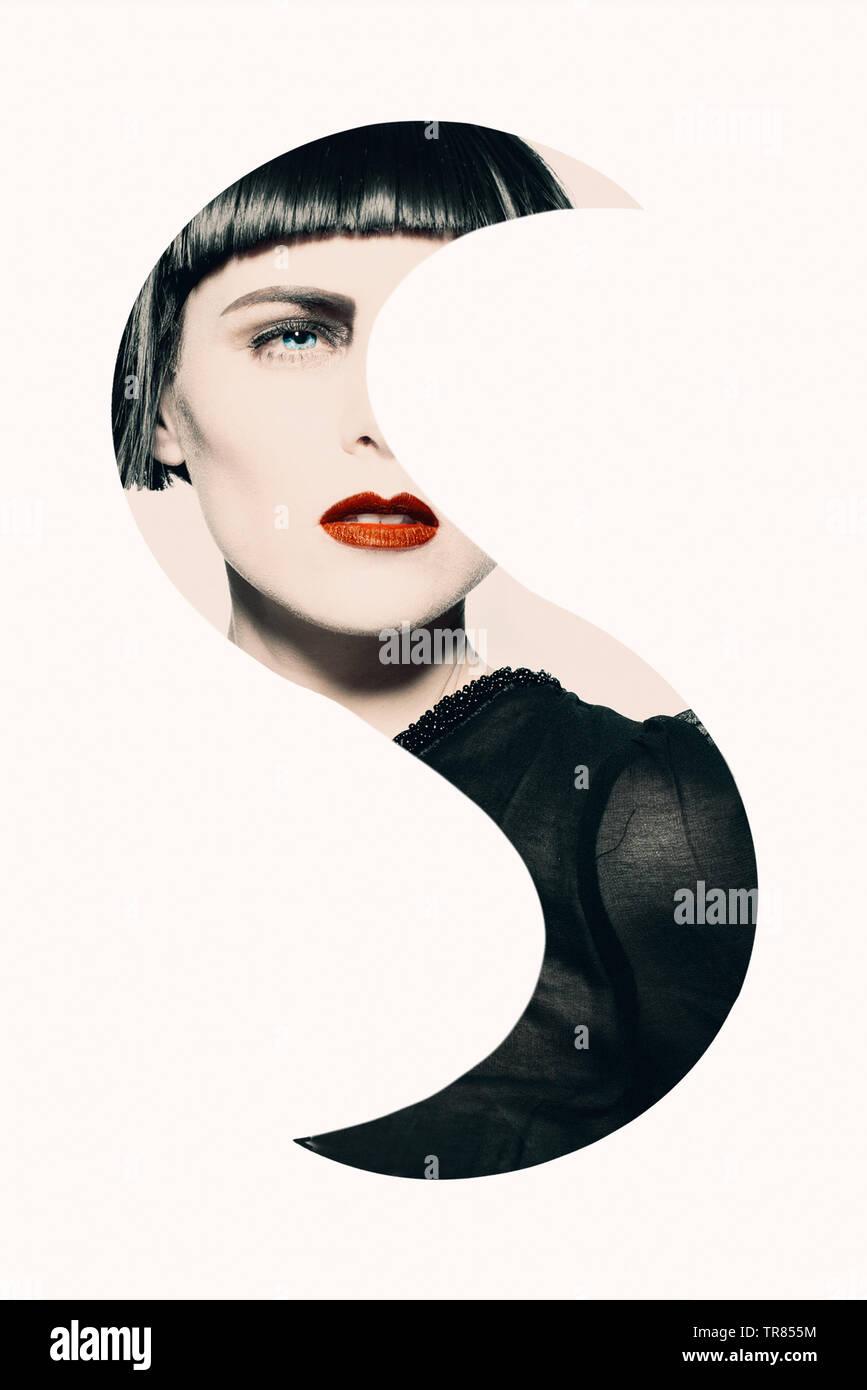 Junge schöne Frau mit schwarzen Haaren und rote Lippen kunstvoll bearbeitet - Stock Image