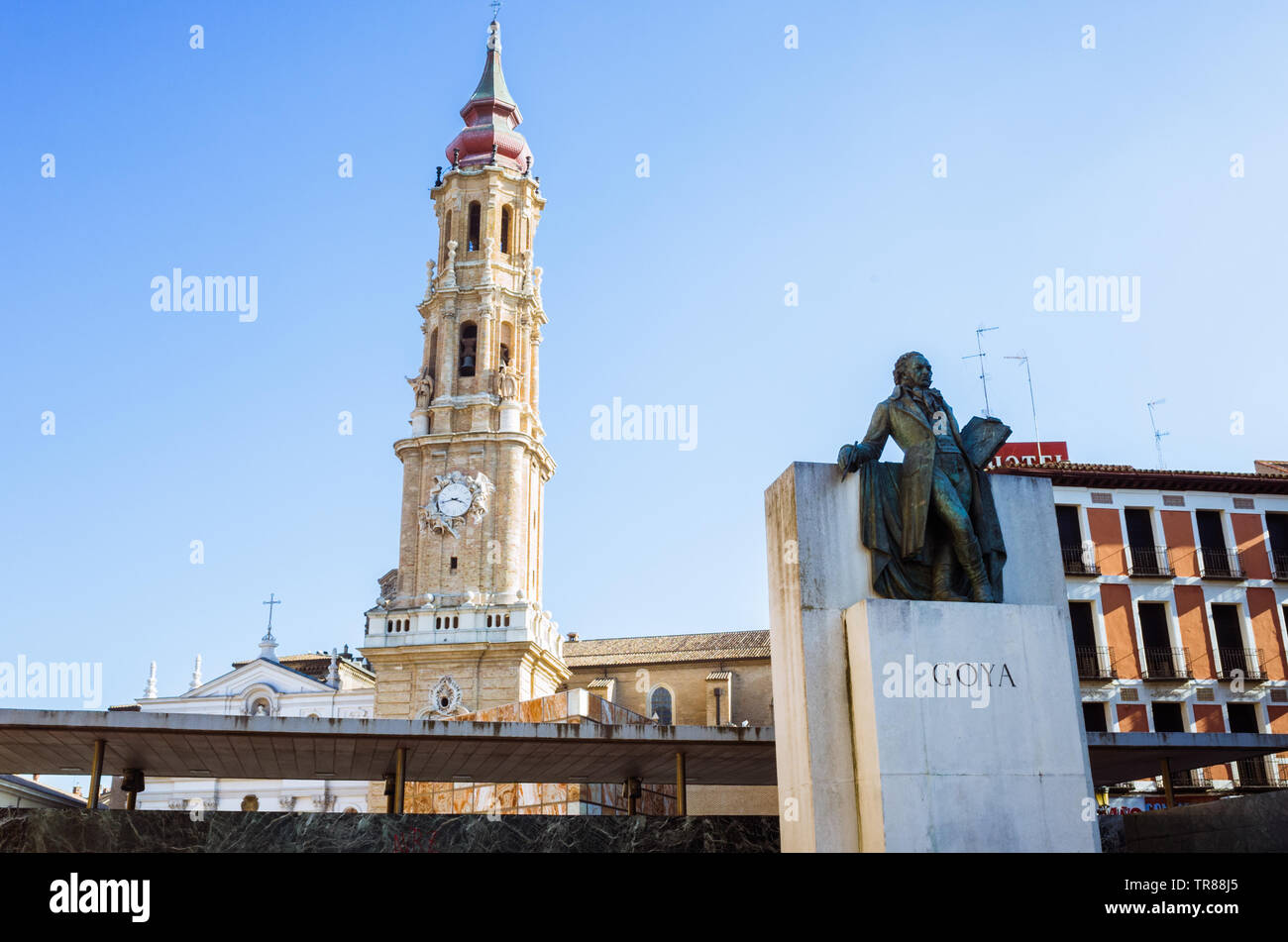 Zaragoza, Aragon, Spain : Bell tower of La Seo cathedral of the Savior and Francisco de Goya monument at the Plaza del Pilar square. - Stock Image