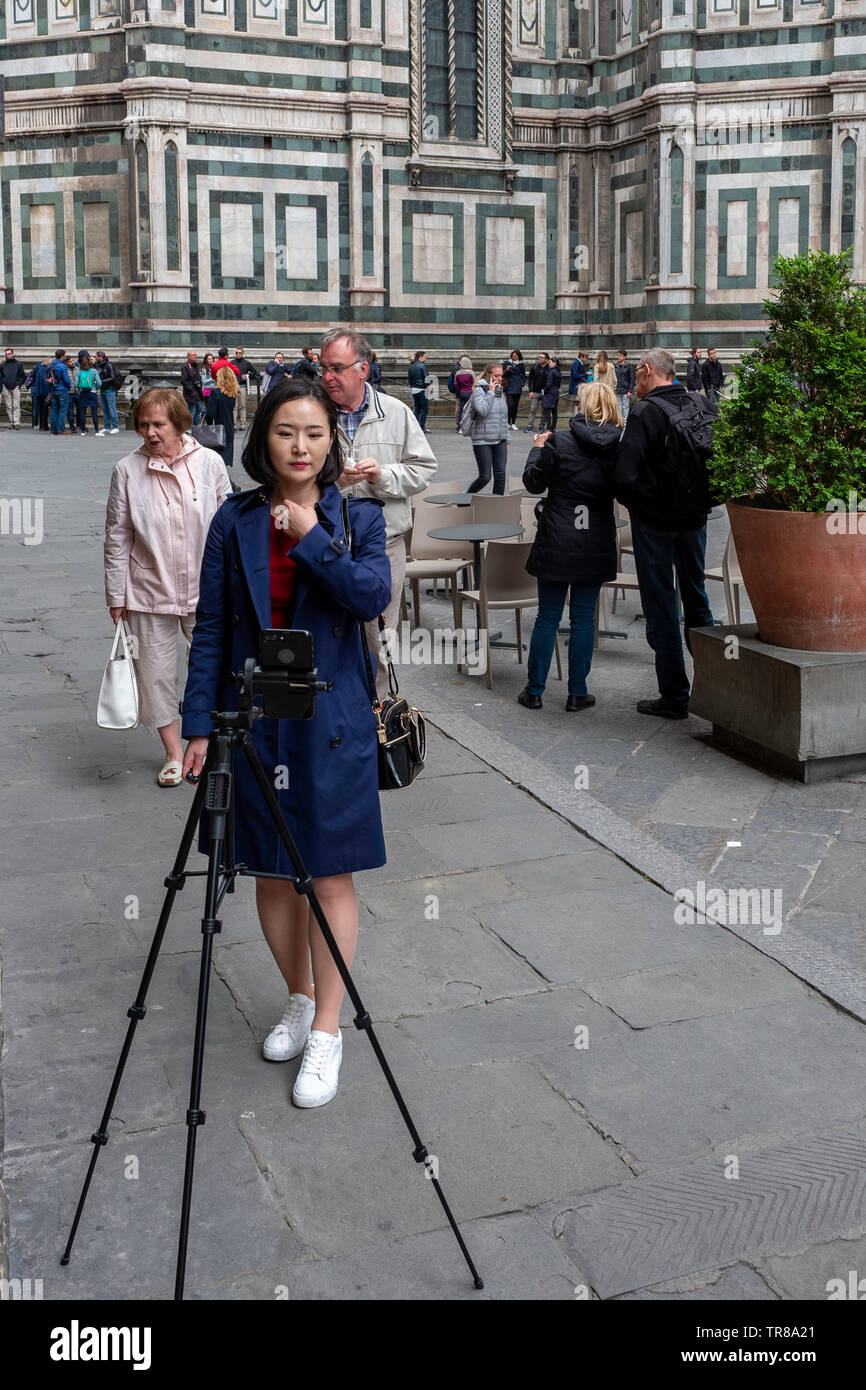 The selfie. Young Chinese woman taking a selfie outside the Duomo, Florence, Italy - Stock Image