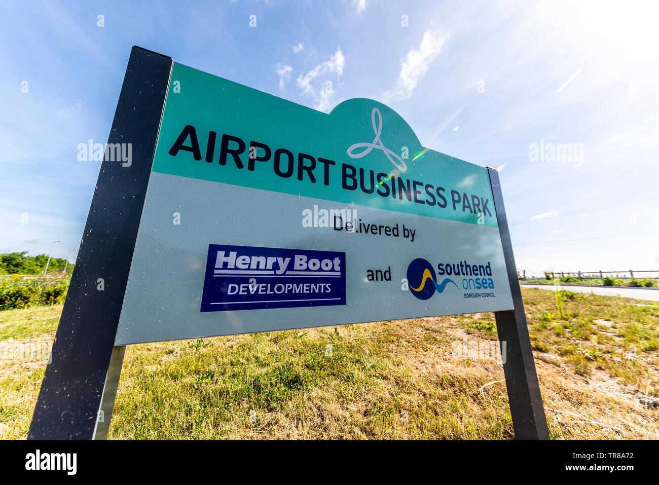 London Southend Airport, Airport Business Park development at Southend on Sea, Essex, UK. Sign on roundabout advertising. Henry Boot Developments - Stock Image
