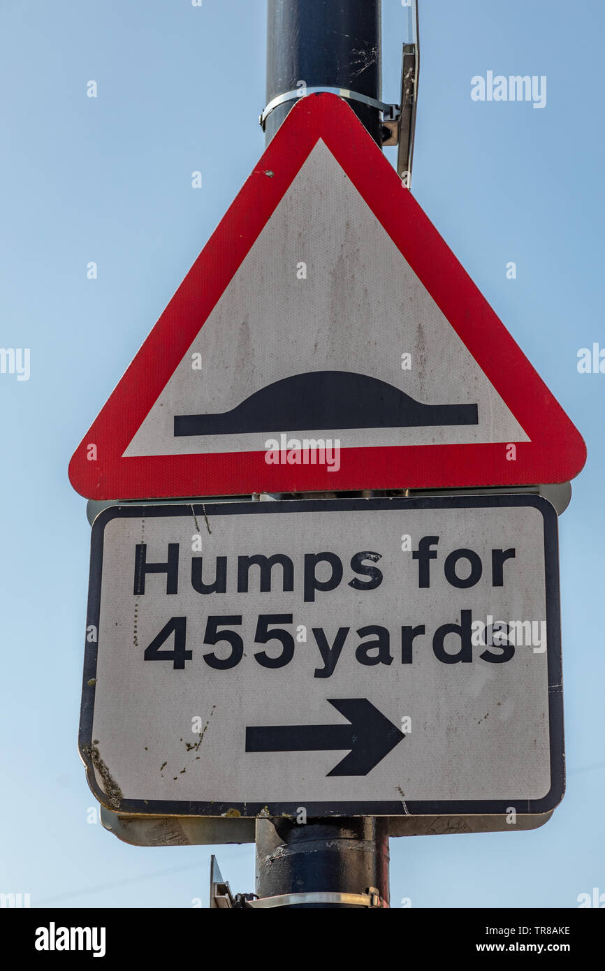 Triangular street sign warning of humps in the road Widnes April 2019 - Stock Image