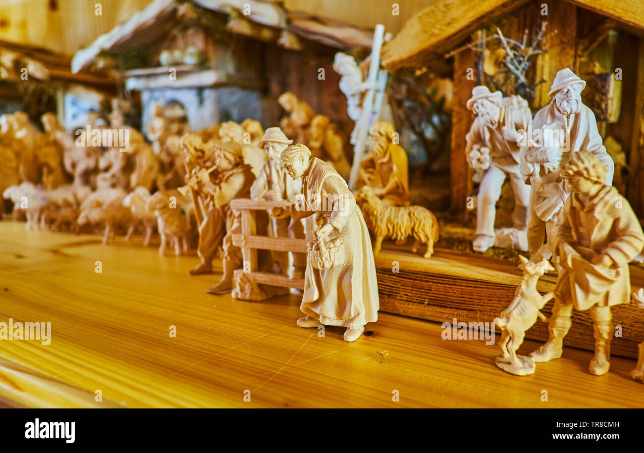 The Small Wooden Figurines Depict The Scenes Of Country Life
