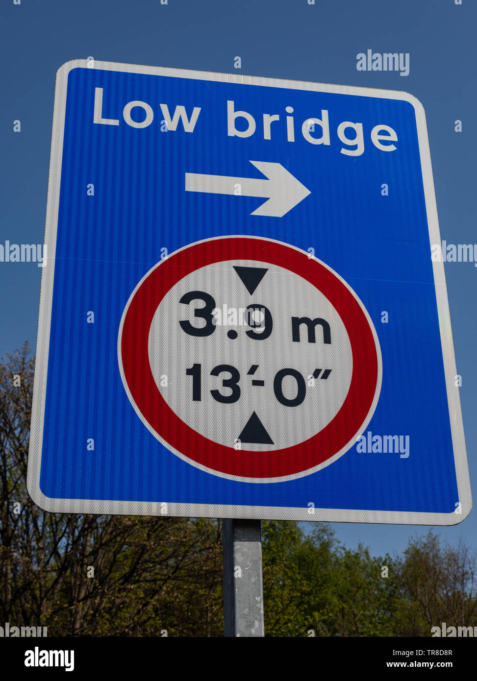 Sign indicating low bridge direction and height Wirral April 2019 Stock Photo