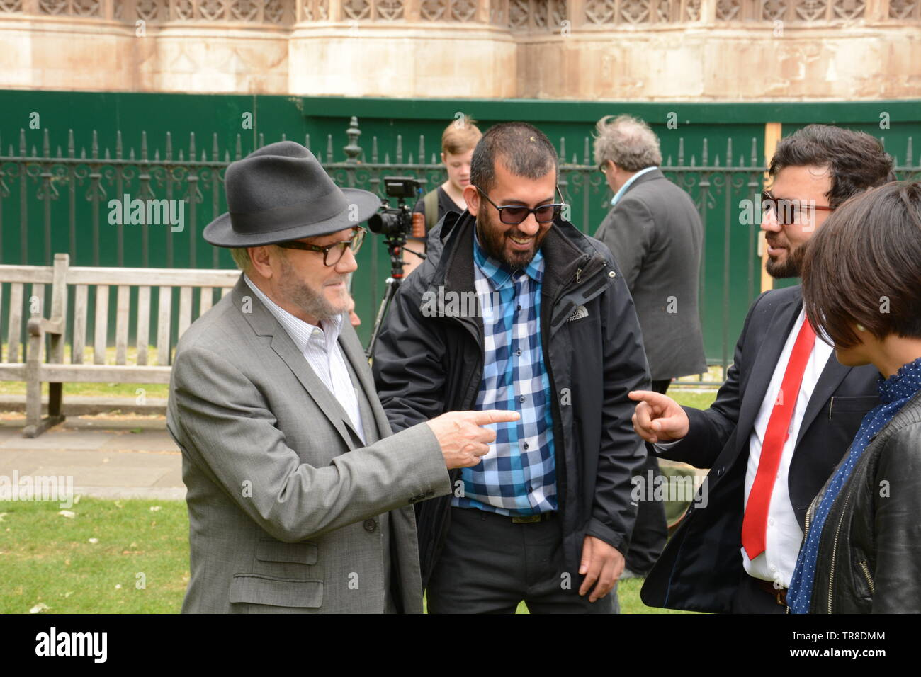 George Galloway in Old Place Yard, Westminster 30th May 2019 some PTM supporters spot George and ask him to speak at their demo. He politely refused. - Stock Image