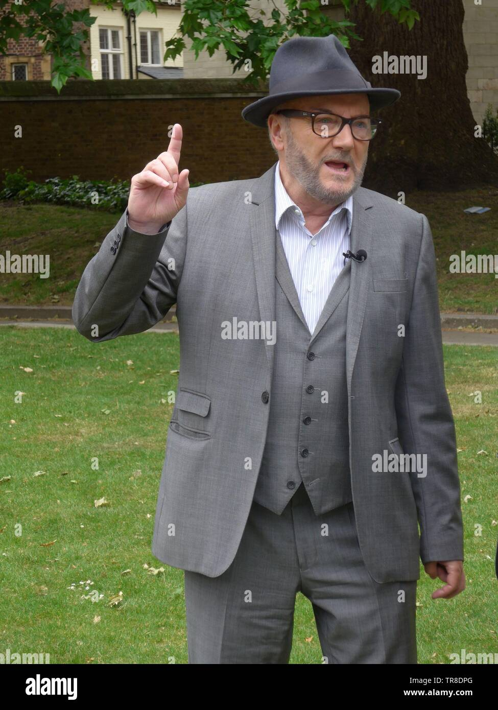 George Galloway in Old Place Yard, Westminster 30th May 2019 discussing Alistair Campbell's expulsion from the Labour Party, among other things. - Stock Image