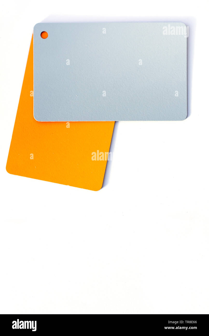 Concept of color cards on white background two colors gray and orange isolate on white background. - Stock Image