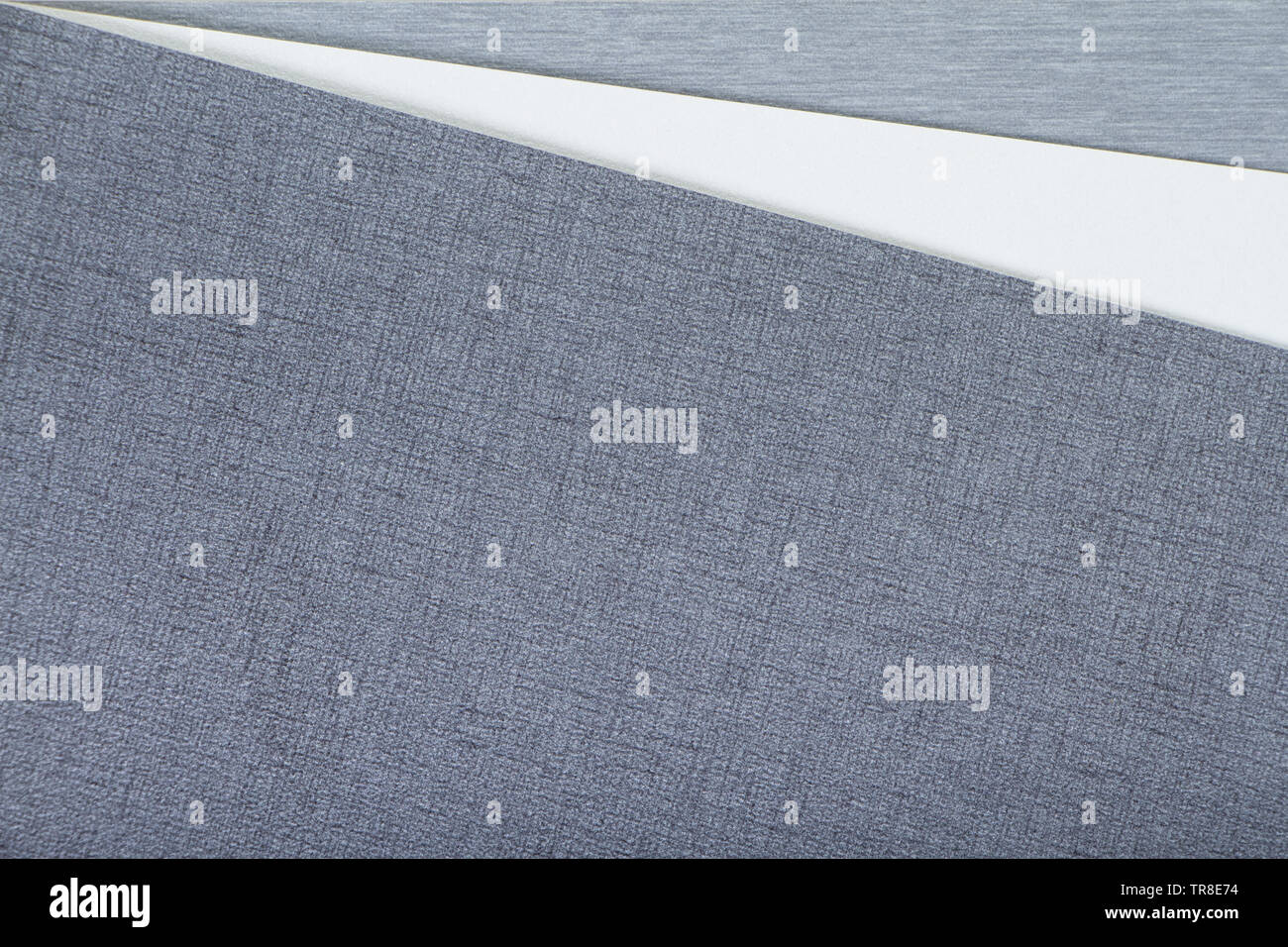 Two-tone white and gray textural colored background, minimalistic concept or background. - Stock Image