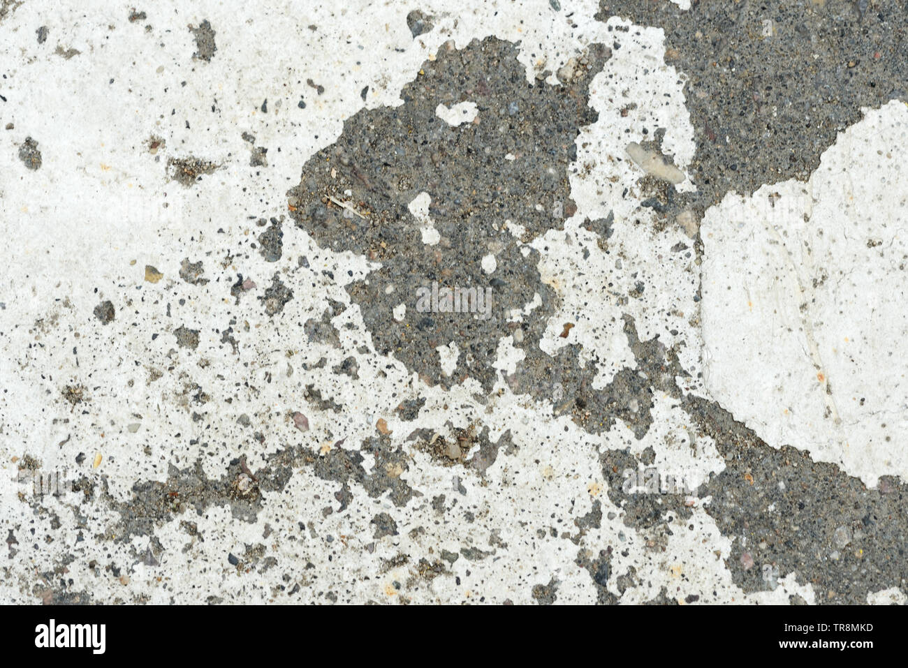 White paint on the old asphalt closeup  Abstract background
