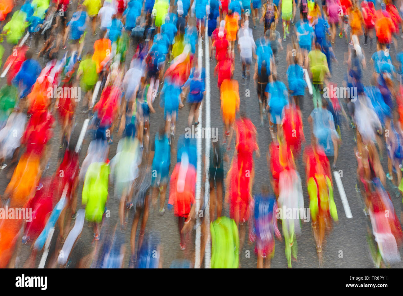 Runners on the street. Athletes in motion. Urban competition. Horizontal - Stock Image