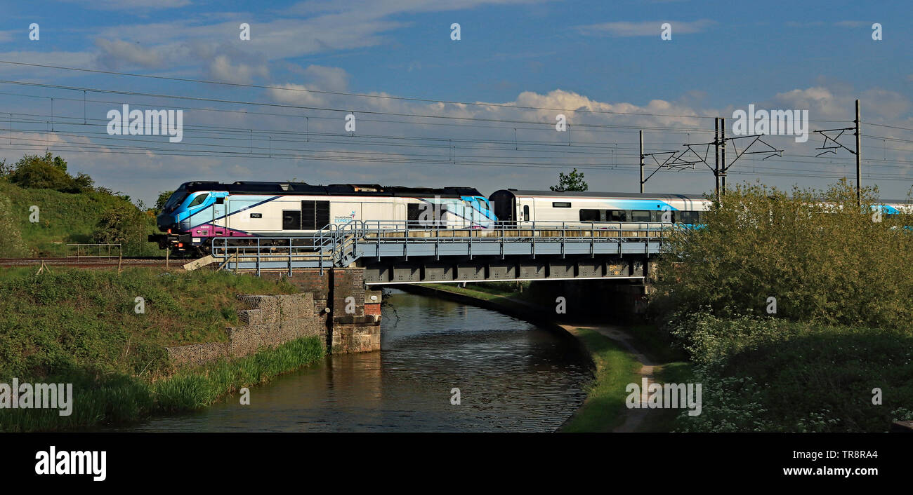 Nearly new Trans Pennine Express diesel locomotive 68031 crosses the Trent and Mersey canal near Sandbach in Cheshire with a new train on test. - Stock Image