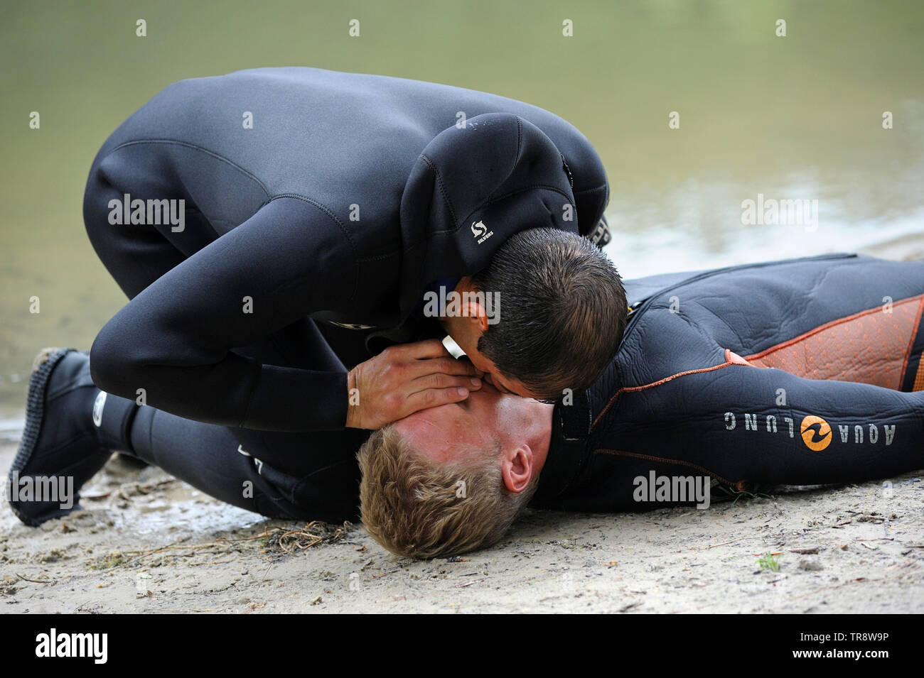 Lesson of artificial respiration. Lifeguard giving drowning mouth-to-mouth resuscitation. August 10, 2018. Kiev, Ukraine - Stock Image