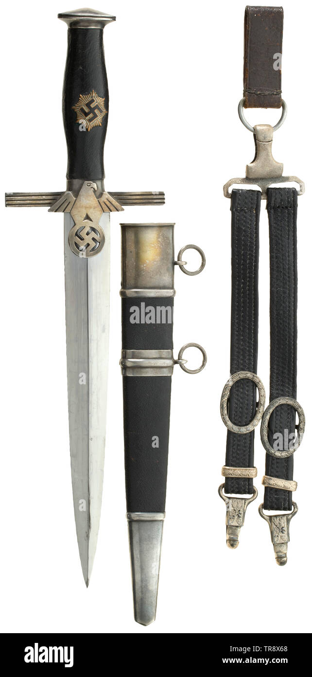 """A dagger M 38 (2nd model) for leaders of the RLB with leather hanger, maker Paul Weyersberg & Co, Solingen The blade with etched maker's mark. Silver-plated pommel and cross-guard. Black leather-covered grip with partially enamelled emblem (small chip). Black leathered steel scabbard with silver-plated fittings. Black leather suspension hanger (leather replaced?) with silvered fittings and RZM marked clip """"M5/10"""". Length 37.5 cm. Very beautiful condition. historic, historical, Reichsluftschutzbund, State Air Protection Corps, organisation, organization, organizations, organ, Editorial-Use-Only Stock Photo"""