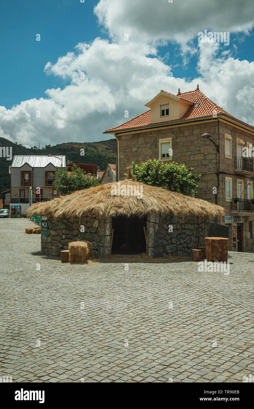 Deserted square with naive medieval fair, in a cloudy day at Loriga. Known as the Portuguese Switzerland for its landscape. - Stock Image