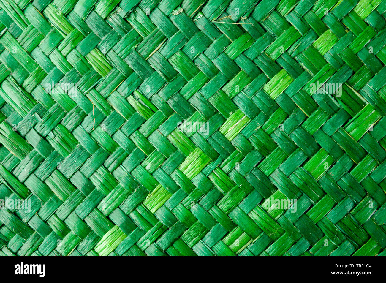 Green Vimini Bamboo weaving texture background pattern - Stock Image