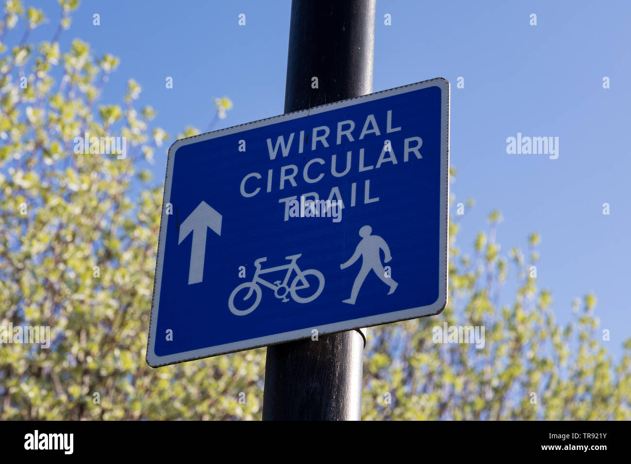 Blue sign for footpath and cycle path for the Wirral Circular Trail Birkenhead Wirral April 2019 Stock Photo