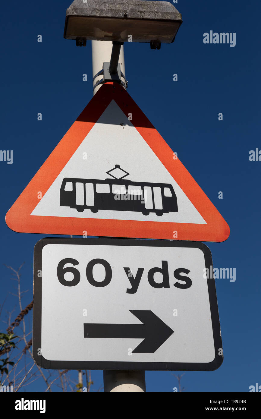 Sign warning of location of trams near the road in Birkenhead Wirral April 2019 - Stock Image