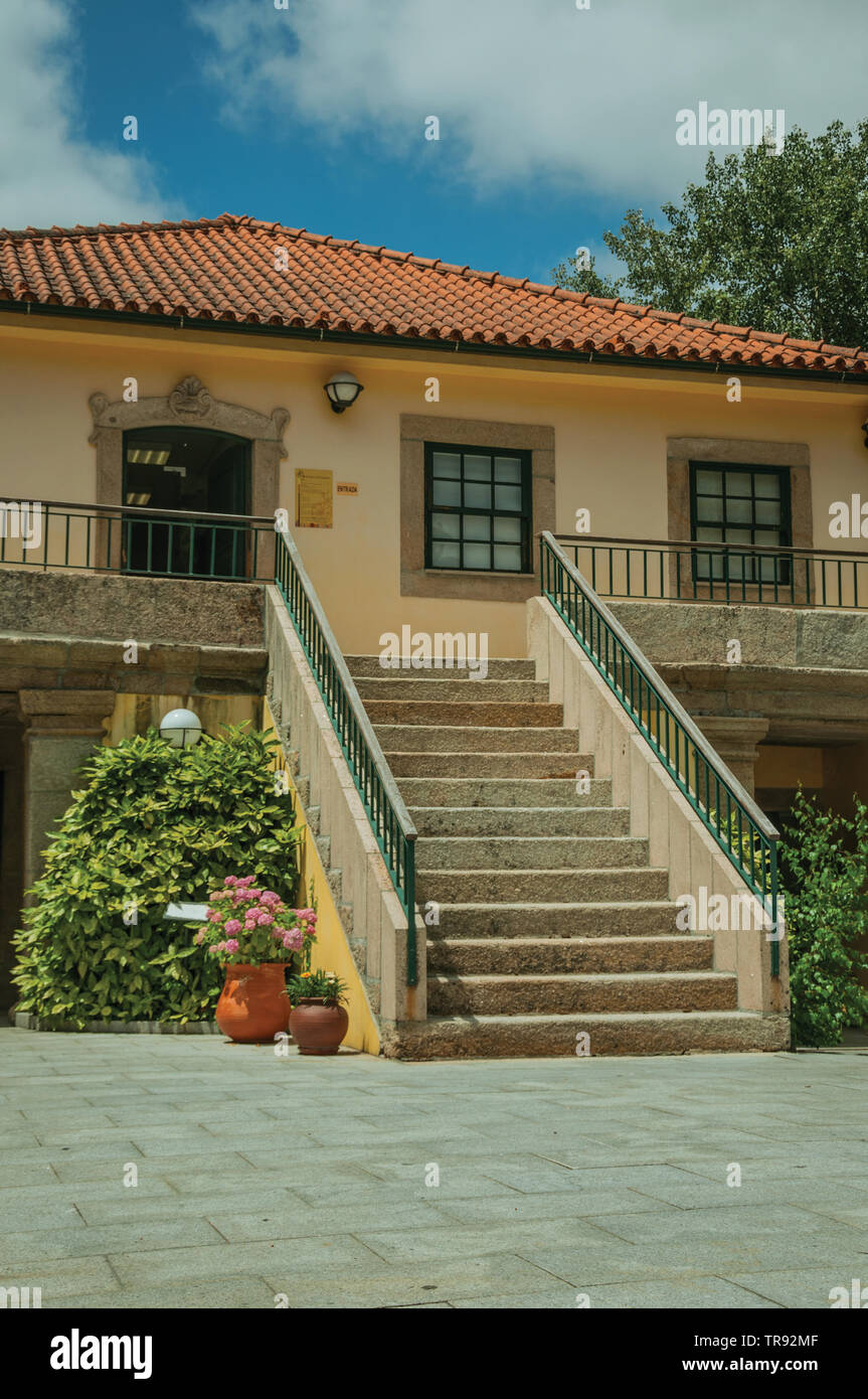 Charming facade of Toy Museum house with stone large staircase at Seia. A nice village of Portugal also known for its delicious cheese. - Stock Image