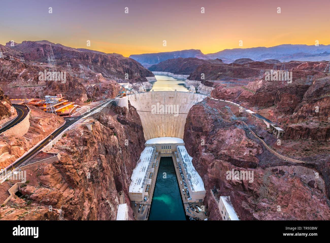 Hooover Dam on the Colorado River straddling Nevada and Arizona at dawn. Stock Photo