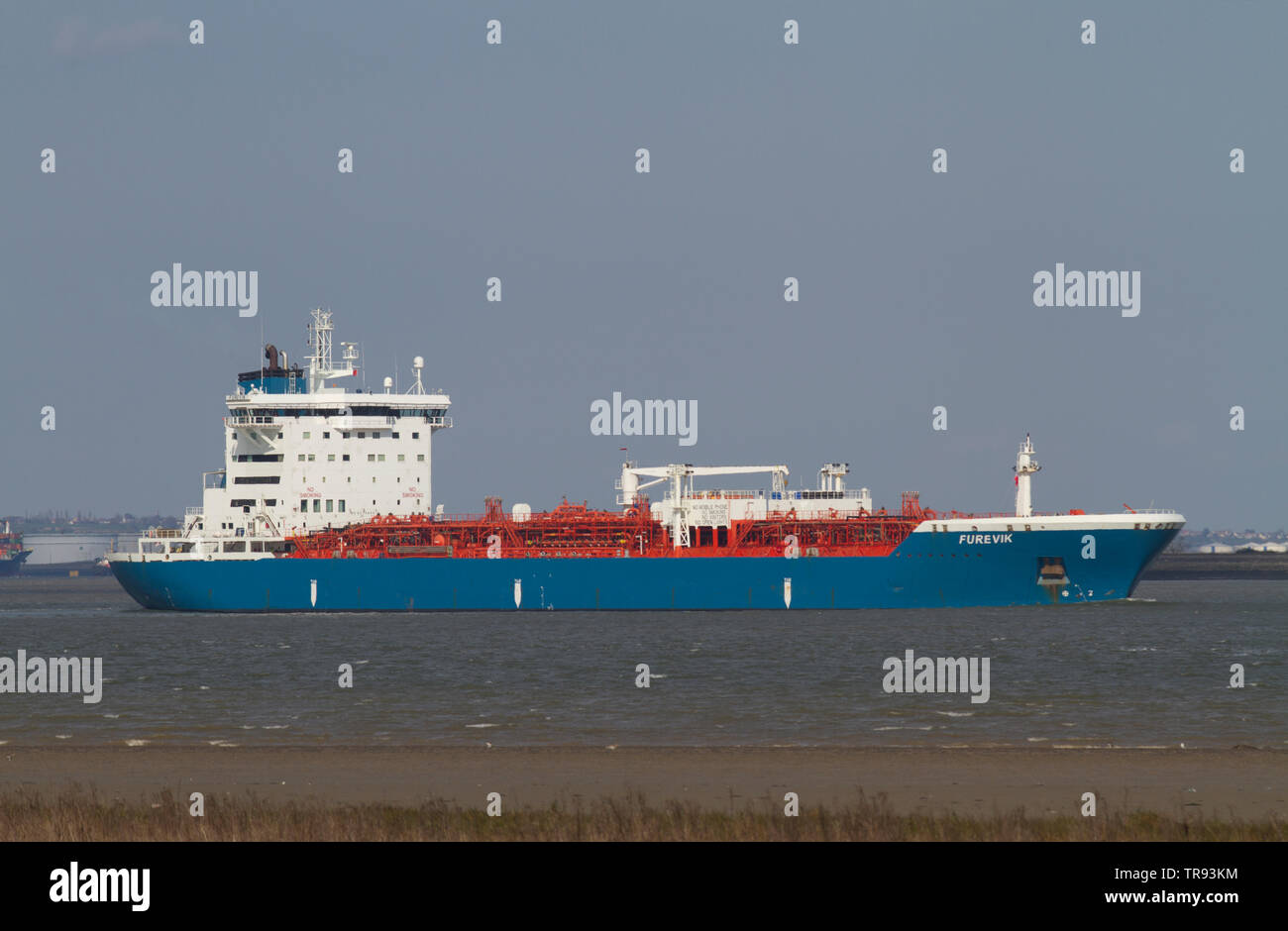 The Furevik which is an oil/chemical tanker ship sailing in the Thames Estuary near Tilbury in Essex. - Stock Image