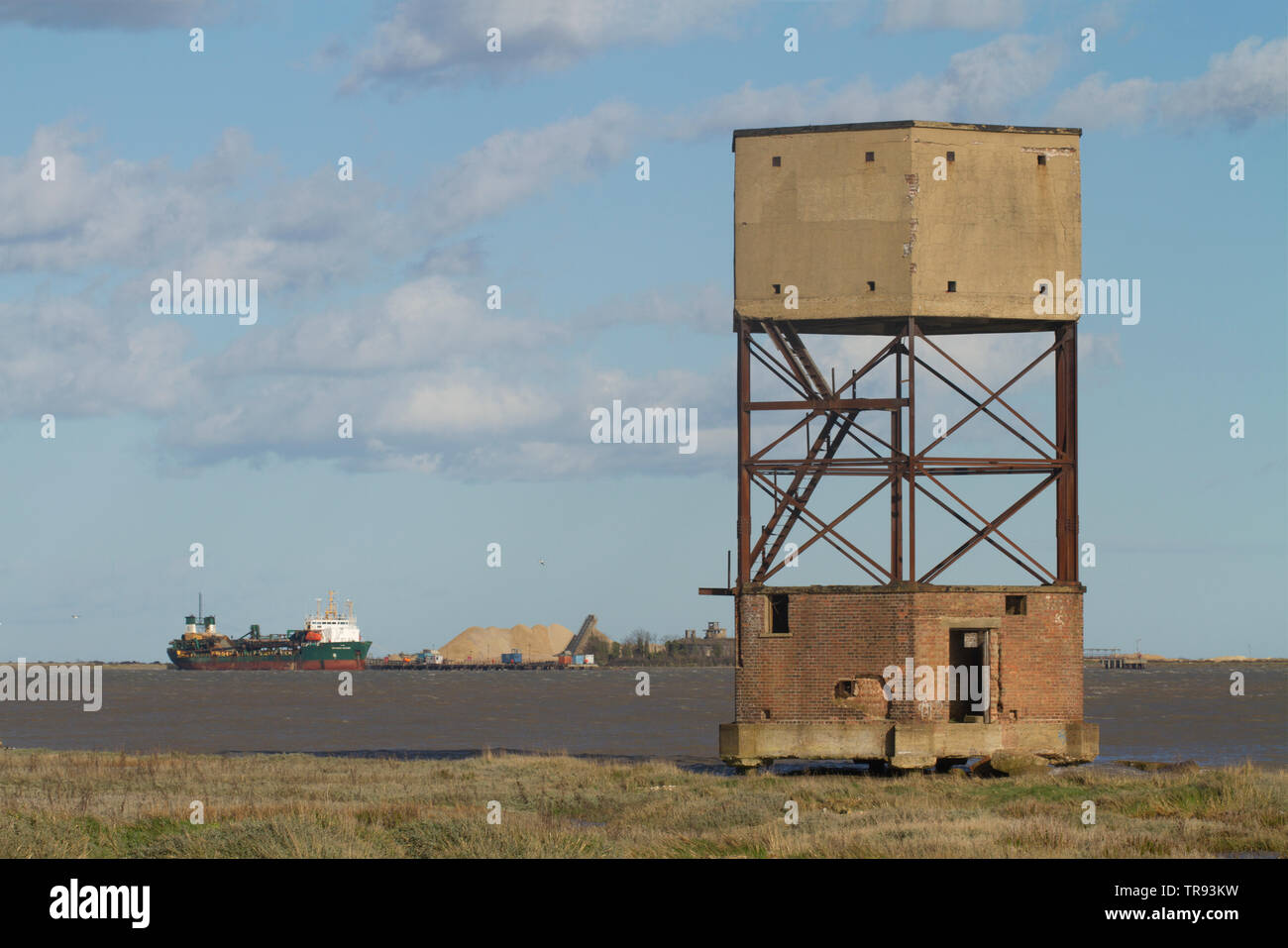 A disused World War 2 radar control tower disguised as a water tower on the banks of the river Thames near Coalhouse Fort, Tilbury, Essex. - Stock Image