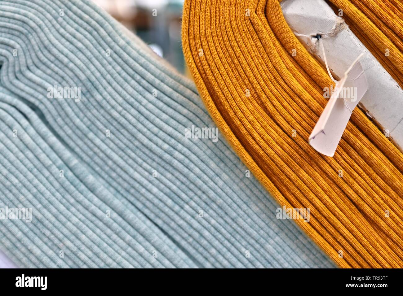 Close up surface of colorful fabrics cloth and textiles being folded and hang up in high resolution - Stock Image