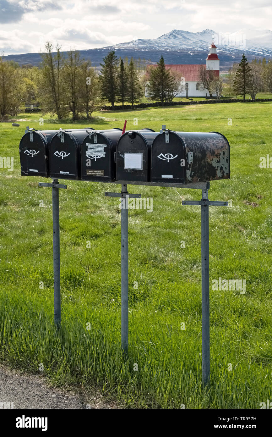 Mailboxes in front of the little 19c church at Möðruvellir in north Iceland - a typical rural scene in early spring (mid May) - Stock Image
