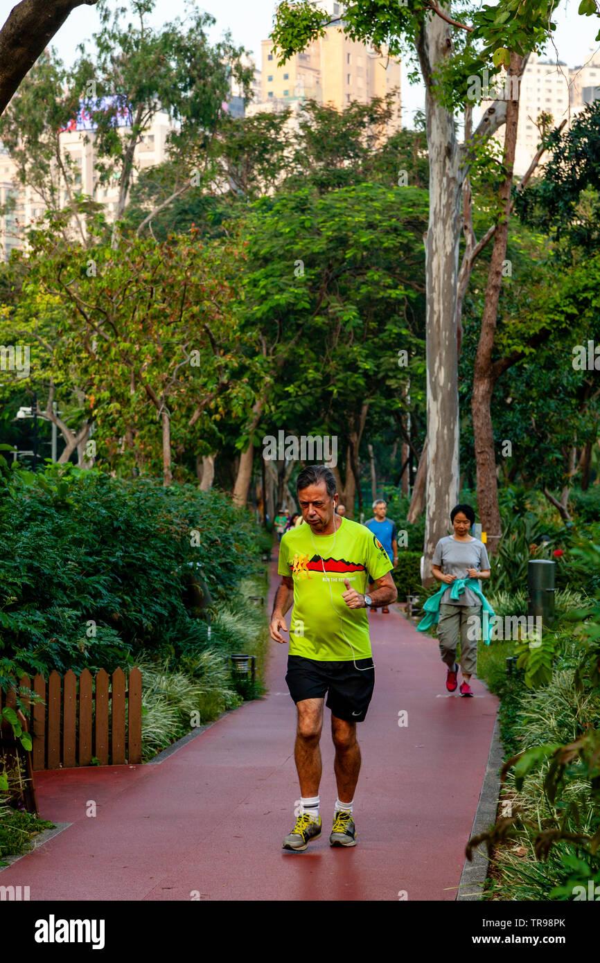 Joggers In Victoria Park, Hong Kong, China - Stock Image