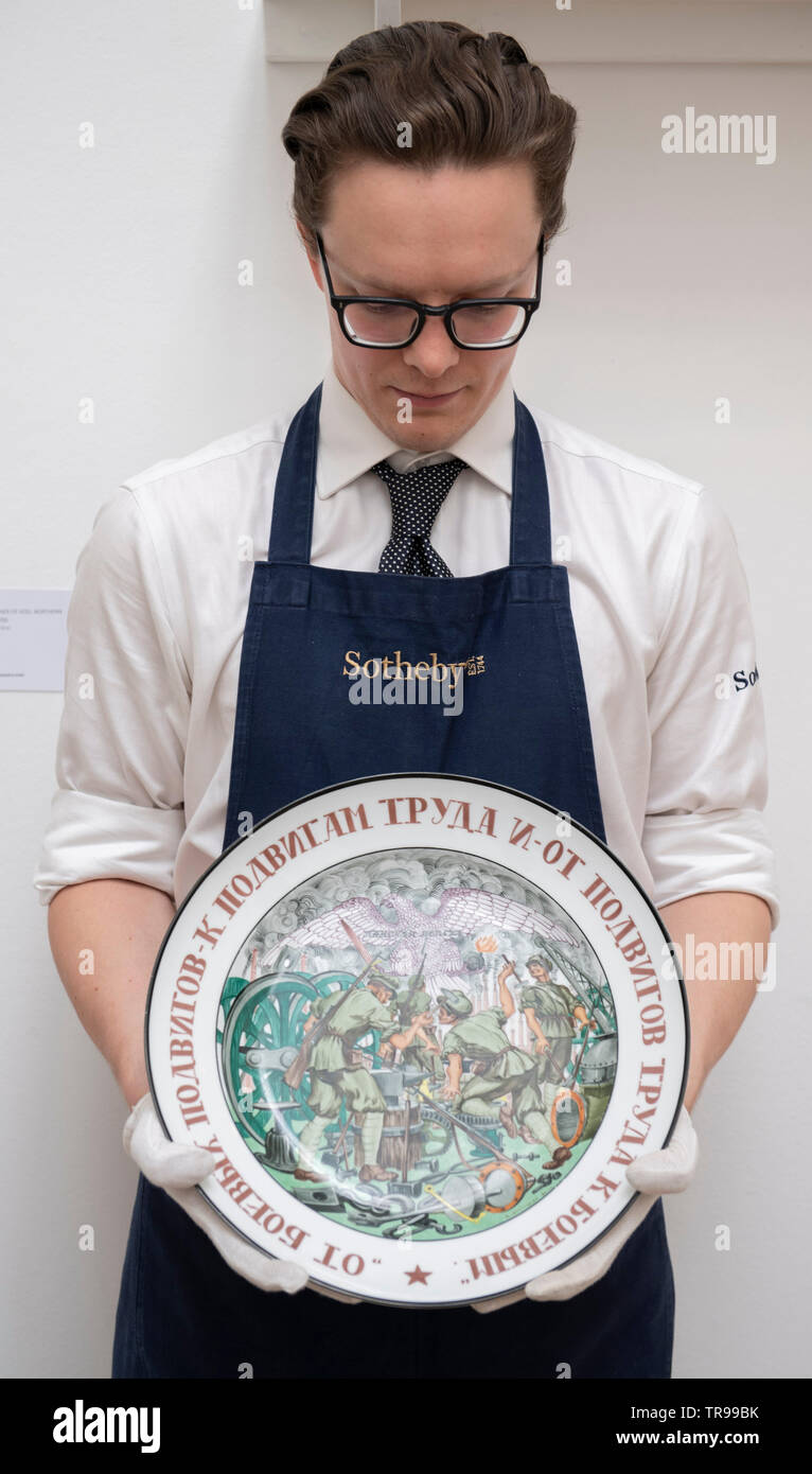 Sotheby's, London, UK. 31st May 2019. From Fabergé and Feodor Rückert to Alexei Bogoliubov and Konstantin Makovsky, works by Russian Masters come together in London for Sotheby's Russian Art sales on 4 June. Image: Feats of Labour: A Soviet porcelain platter, State Porcelain Factory, Petrograd, circa 1921. Estimate £30,000-50,000. Credit: Malcolm Park/Alamy Live News. - Stock Image
