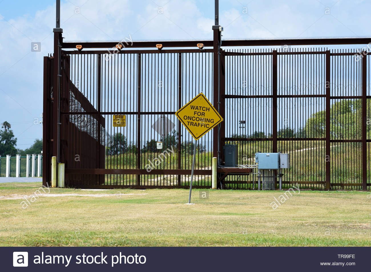 Brownsville Border Fence. Border Fence. United States - Mexico Border Fence in Brownsville, Texas. The Border Wall. Fence on Mexican Border in Texas. Stock Photo