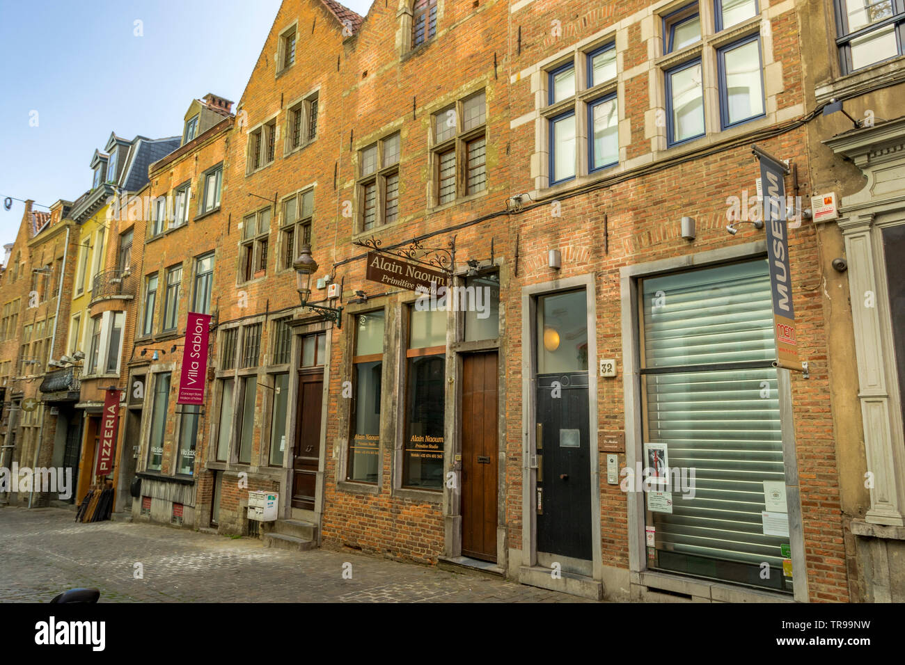 Small retail shops and studios in Rue Sainte-Anne a small cobbled street In Brussels ,Belgium - Stock Image