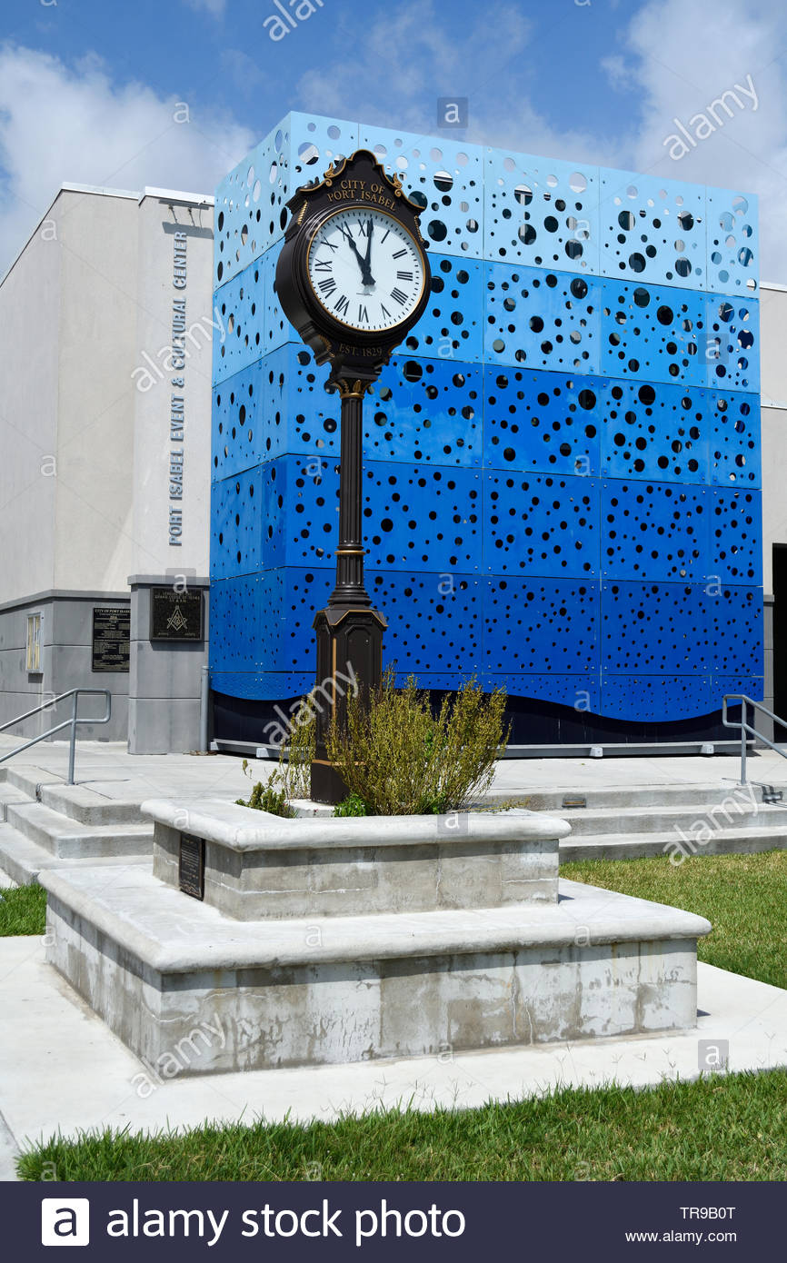 Street Clock. City of Port Isabel Texas Street Clock. Port Isabel Event and Cultural Center. Clock with Roman Numerals. Clock. Tall Clock. Clock Face. - Stock Image