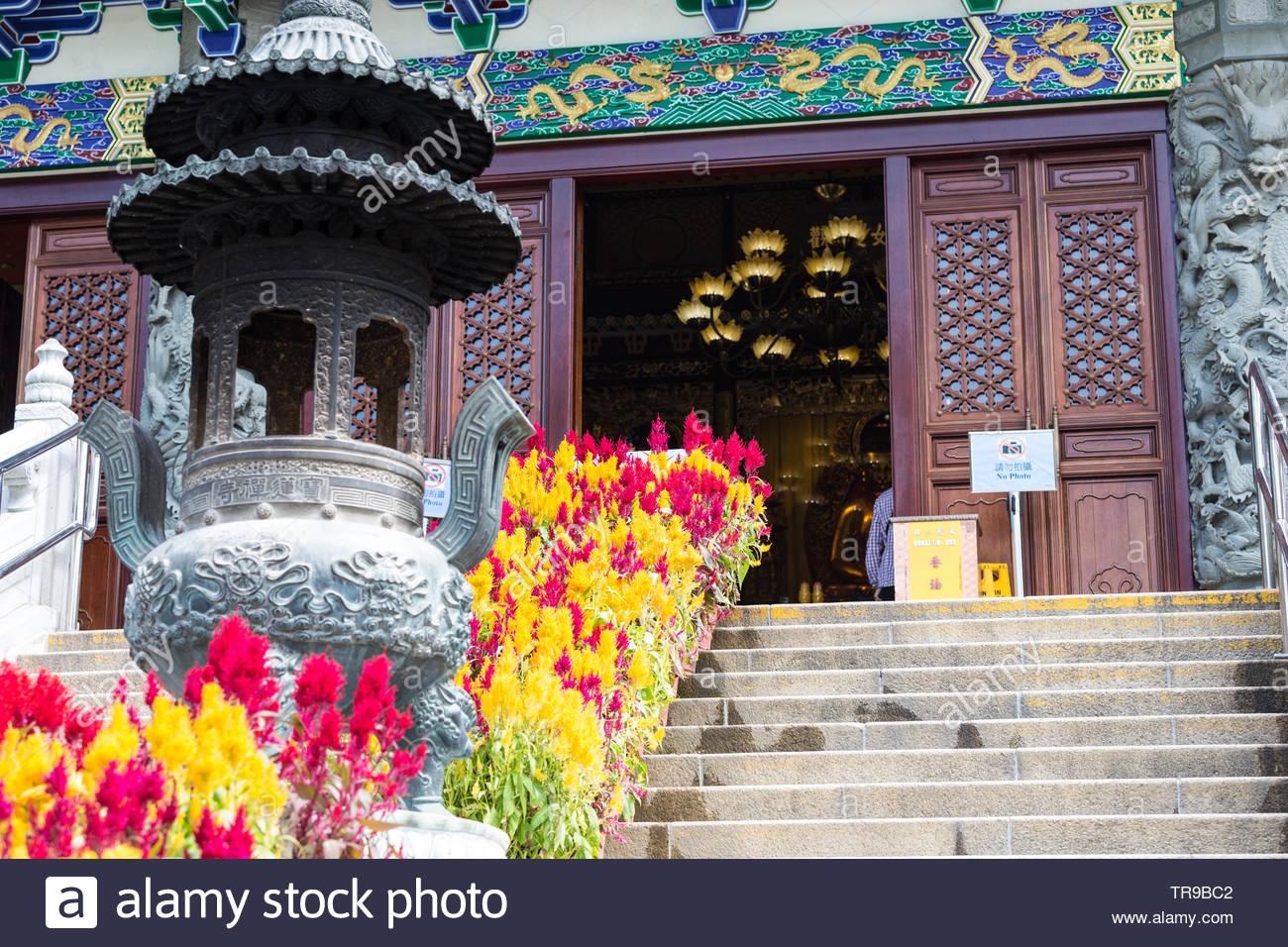 Po Lin Monastery, located on Ngong Ping Plateau, on Lantau Island, Hong Kong - Stock Image