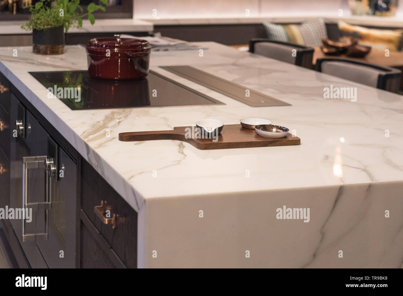 Marble Top Kitchen Island With Ceramic Bowls On Wooden Board Stock Photo Alamy