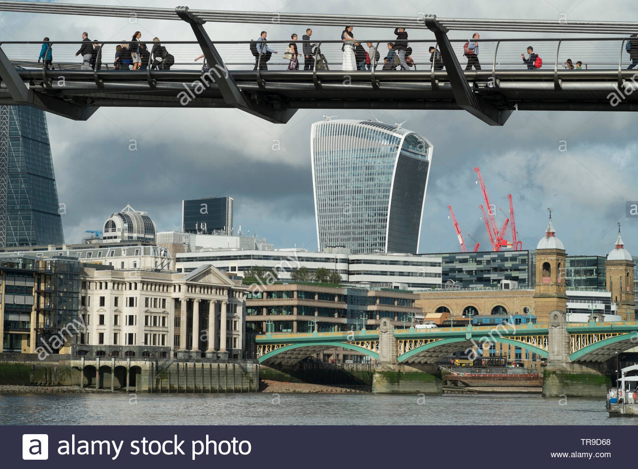The Thames Millenium Bridge and the City of London Walkie-Talkie building. - Stock Image